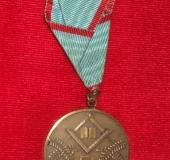 Jewel on ribbon Hiram Prague av